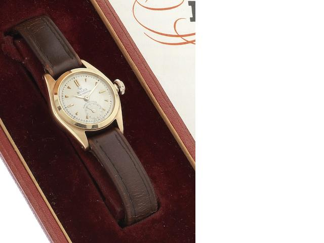 Rolex. A fine 18ct rose gold lady's automatic wristwatch together with original fitted box and papers Ref:4486, Case No.593655, Sold 1st September 1952