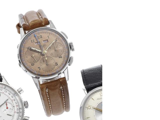 Heuer. A fine stainless steel triple calendar chronograph wristwatch Case No.60692, Movement No.500386, Circa 1940