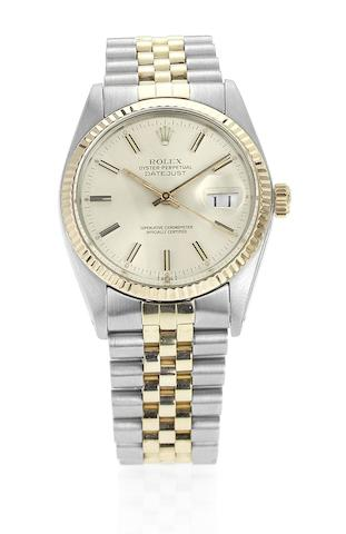 Rolex. A stainless steel and gold automatic calendar bracelet watch together with Rolex box and punched papers, swing tag and instructions Ref:16013, Case No.6111267, Sold 30th March 1981