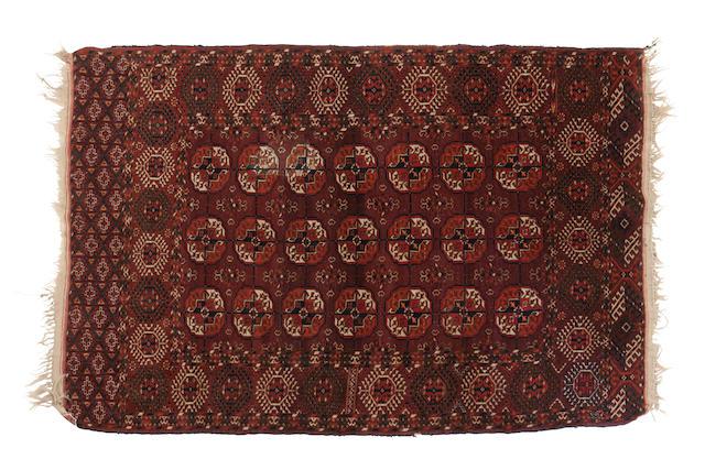 A Tekke Turkoman rug 175cm x 129cm,  122 x 90cm, and 81cm x 77cm