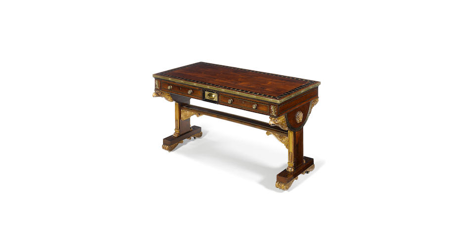 A fine Regency rosewood and crossbanded, ebony and brass inlaid and mounted parcel gilt library table the design attributed to Thomas Hope, the manufacture attributed to George Oakley