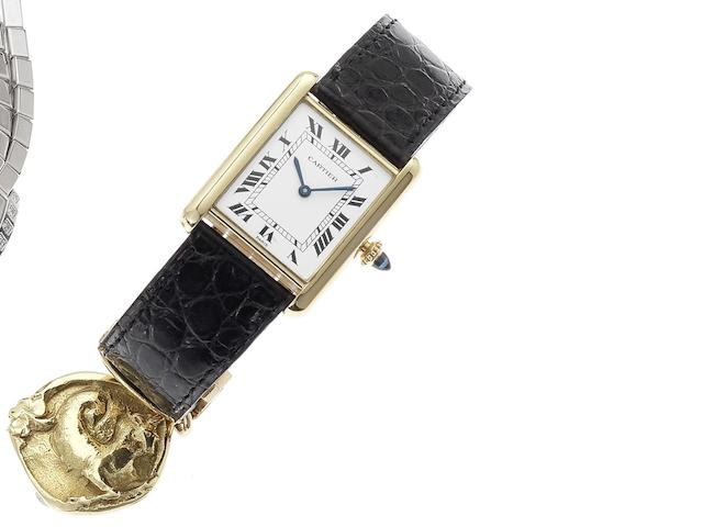 Cartier. An 18ct gold manual wind wristwatch together with 18ct gold Cartier fob Tank, Recent