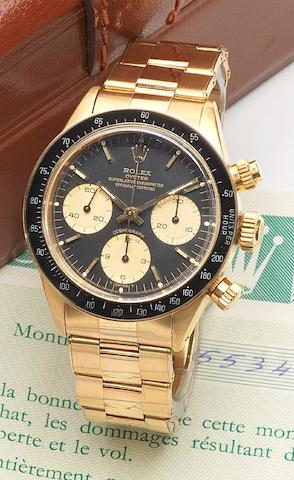 Rolex. A very fine and rare 18ct gold chronograph bracelet watch together with fitted presentation box, instructions and guaranteeRef:6263, Case No.5534497, Cosmograph, Sold December 1979