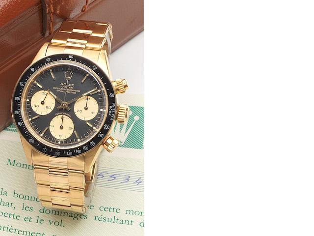 Rolex. A very fine and rare 18ct gold chronograph bracelet watch together with fitted presentation box, instructions and guarantee Ref:6263, Case No.5534497, Cosmograph, Sold December 1979