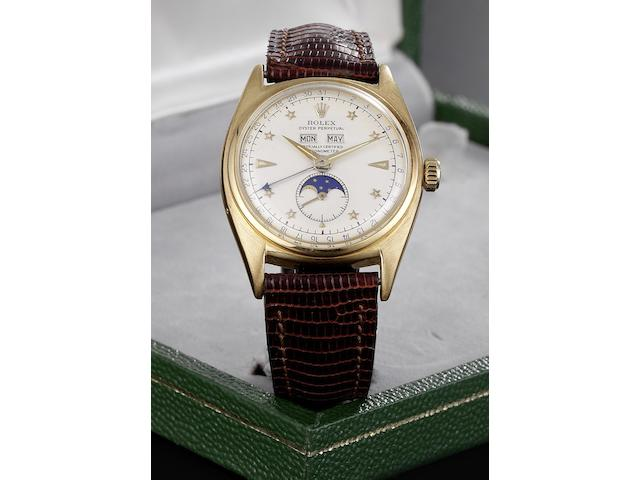 Rolex. A fine and rare 18ct gold triple calendar wristwatch with moonphase and star dial Oyster Perpetual, Ref:6062, Case No.788595, Movement No.N52152, Circa 1955