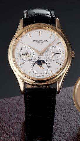 Patek Philippe. A fine 18ct rose gold automatic perpetual calendar wristwatch together with Patek Philippe winding box and Certificate of Origin Ref:3940R, Case No.4294727. Movement No.3128458, Sold 14th November 2005