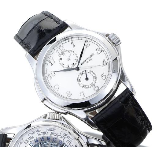 Patek Philippe. A fine 18ct white gold dual time wristwatch together with presentation box and Certificate of OriginTravel Time, Ref:5134G, Case No.4171430, Movement No.3087271, Sold March 2004