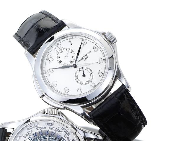 Patek Philippe. A fine 18ct white gold dual time wristwatch together with presentation box and Certificate of Origin Travel Time, Ref:5134G, Case No.4171430, Movement No.3087271, Sold March 2004