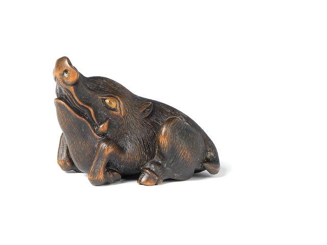 A wood netsuke of a recumbent wild boar By Naito Toyomasa (1773-1856), Tanba, 1855