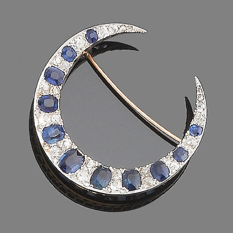 A sapphire and diamond crescent brooch