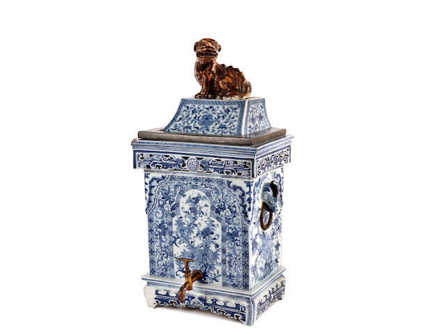 An 18th Century Chinese blue and white water cistern and cover