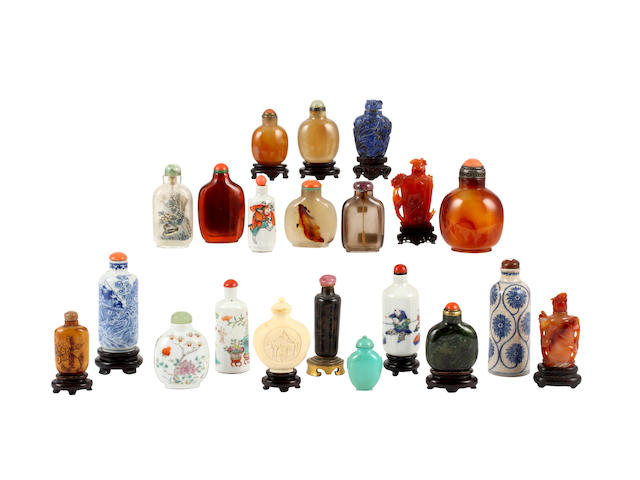 A collection of twenty one Chinese snuff bottles and stoppers and eleven stands, including: