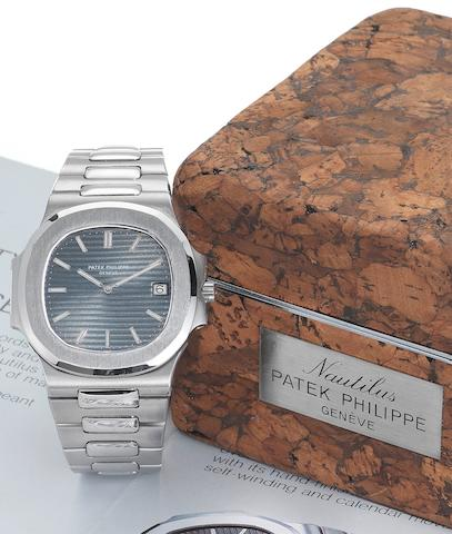 Patek Philippe. A fine and rare stainless steel automatic calendar wristwatch with original Patek Philippe Nautilus cork box together with Extract from Archives Jumbo Nautilus