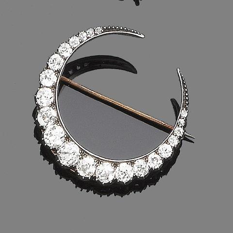 A late 19th century diamond crescent brooch
