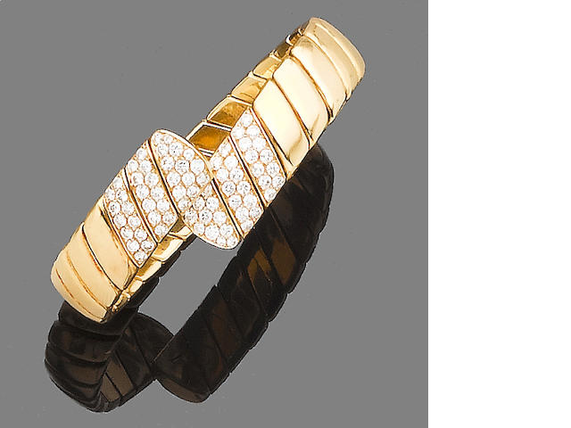 A diamond-set sprung torque bangle, by Cartier