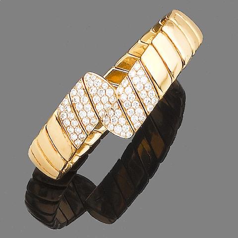 A diamond-set sprung torque bangle, by Cartier
