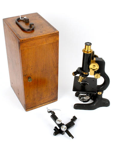 An early 20th century walnut cased monocular microscope by Bausch & Lomb Optical Co.
