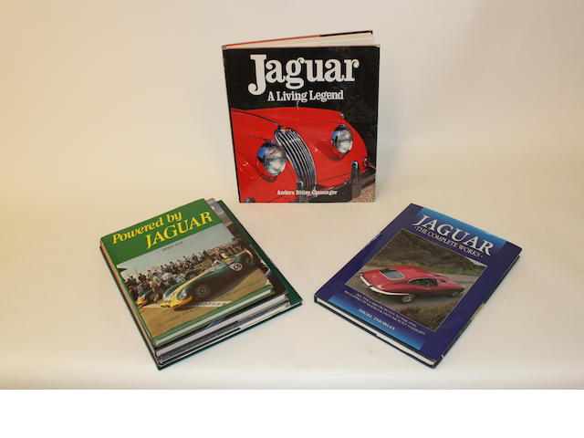 A large collection of books relating to Jaguar Cars
