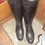 A pair of black leather riding boots