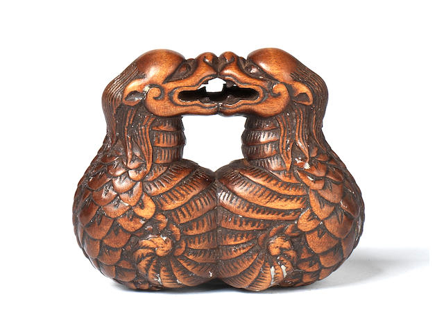 A rare wood netsuke of two dragons 18th century