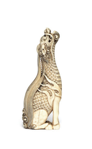 An ivory netsuke of a kirin By Yoshimasa, Kyoto, early 19th century