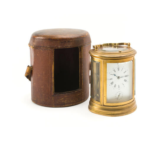 An oval gilt brass repeating alarm carriage clock French, late 19th century