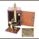 A 19th century mahogany cased lacquered brass monocular microscope by J & C Robbins,