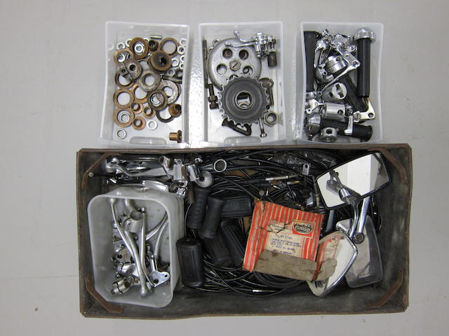 A quantity of cables, handlebar controls, mirrors gear levers and kick starts,