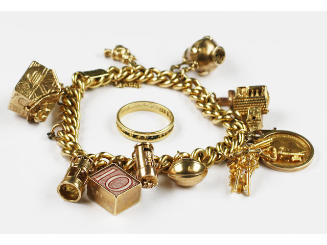 An 18ct gold charm bracelet and mourning ring