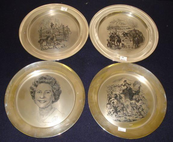 An Elizabeth II 1977 silver Commemorative plate, by Toye Kenning & Spencer Ltd, boxed, together with three others Dickens scenes with certificates, 55ozs approximately total.