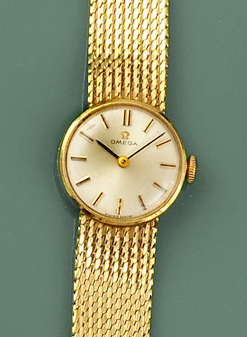 Omega: A lady's 18ct gold bracelet watch