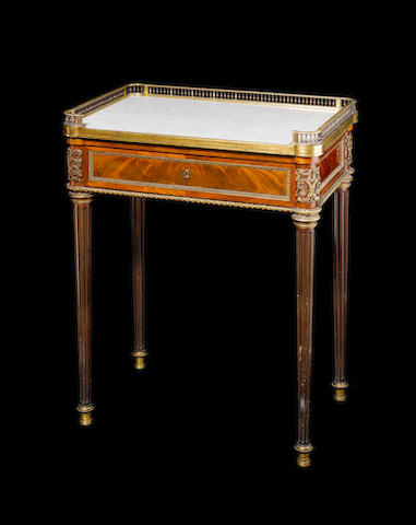 A mahogany Louis XVI style table by A.Beurdeley