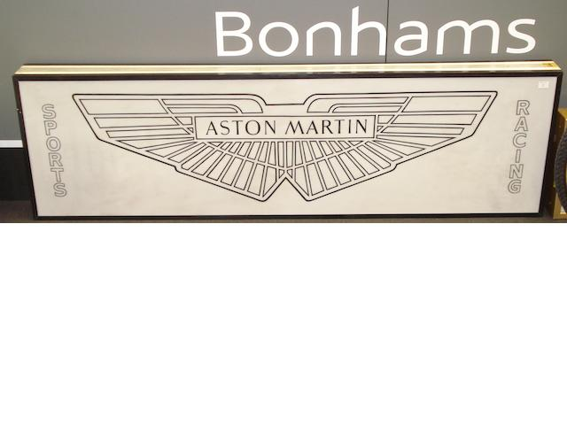 A large Aston Martin themed light box,