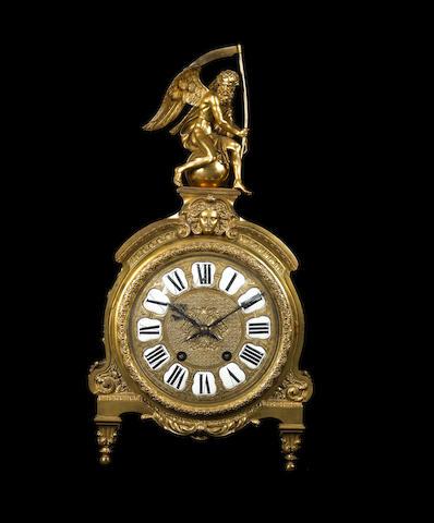 A French late 19th century Louis XIV style gilt bronze mantel clock à la figure du temps