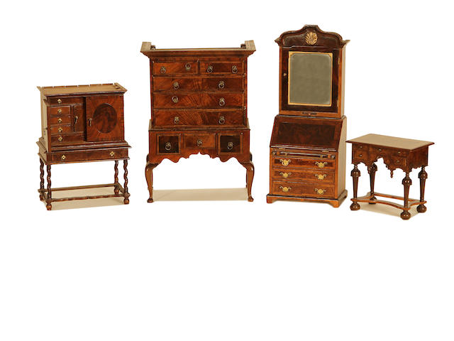MINIATURE FURNITURE Four pieces of early 18th century style walnut furniture