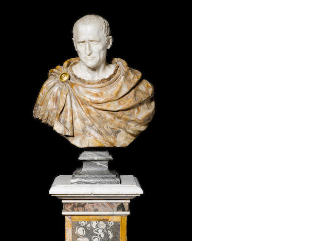 A pair of Italian 17th century carved white marble and alabaster fiorito busts of Julius Caesar and Hadrian after the Antique