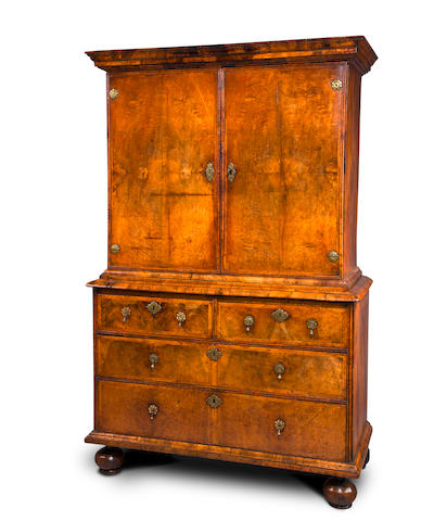 A Queen Anne walnut and featherbanded cabinet on chest