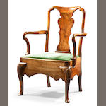 A George II carved walnut commode open armchair