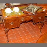 A walnut writing desk,