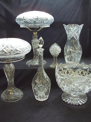 A collection of glass vases and lamps