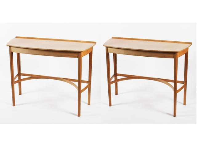 A pair of Barnsley walnut bow front side tables