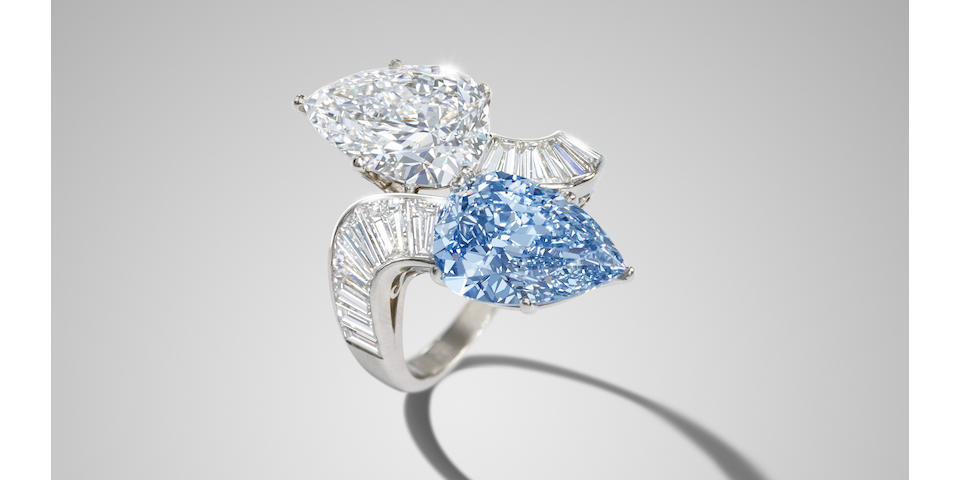 A diamond and blue diamond crossover ring