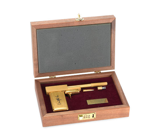 The Man With The Golden Gun, 1974: a replica golden gun, autographed by Christopher Lee, 20th Anniversary Edition,