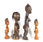A pair of Yoruba male ibejis, and two other figures 4