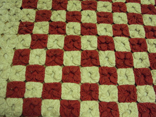 A red and white patchwork quilt
