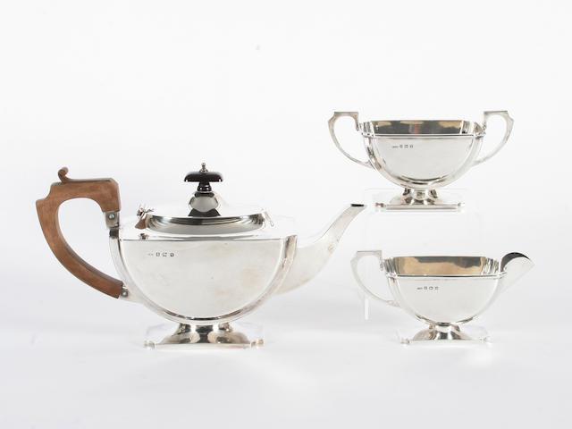 An Art Deco silver three piece tea set By E W Haywood, Birmingham, 1920,  (3)