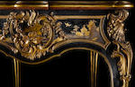 A rare ormolu-mounted ebony and ebonised Japanese lacquer bureau plat in the rocaille style by Emmanuel Alfred Beurdeley