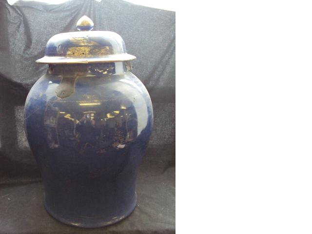 An Oriental floor vase and cover