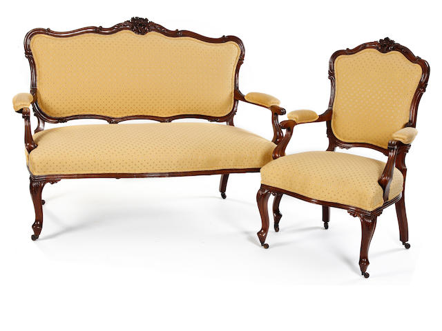 A Victorian mahogany-framed three-piece salon suite