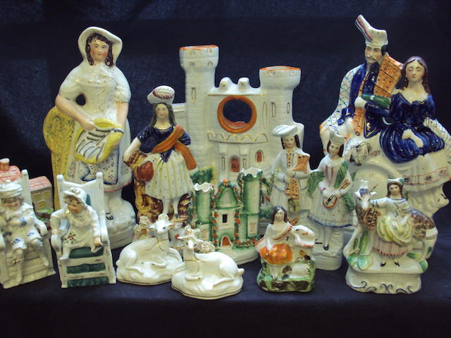 A small collection of Staffordshire figures